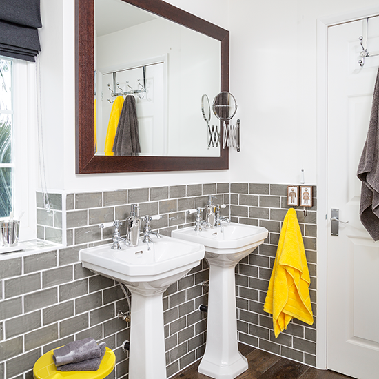 Bathroom ideas to make the most of bright colours for Bright yellow bathroom ideas